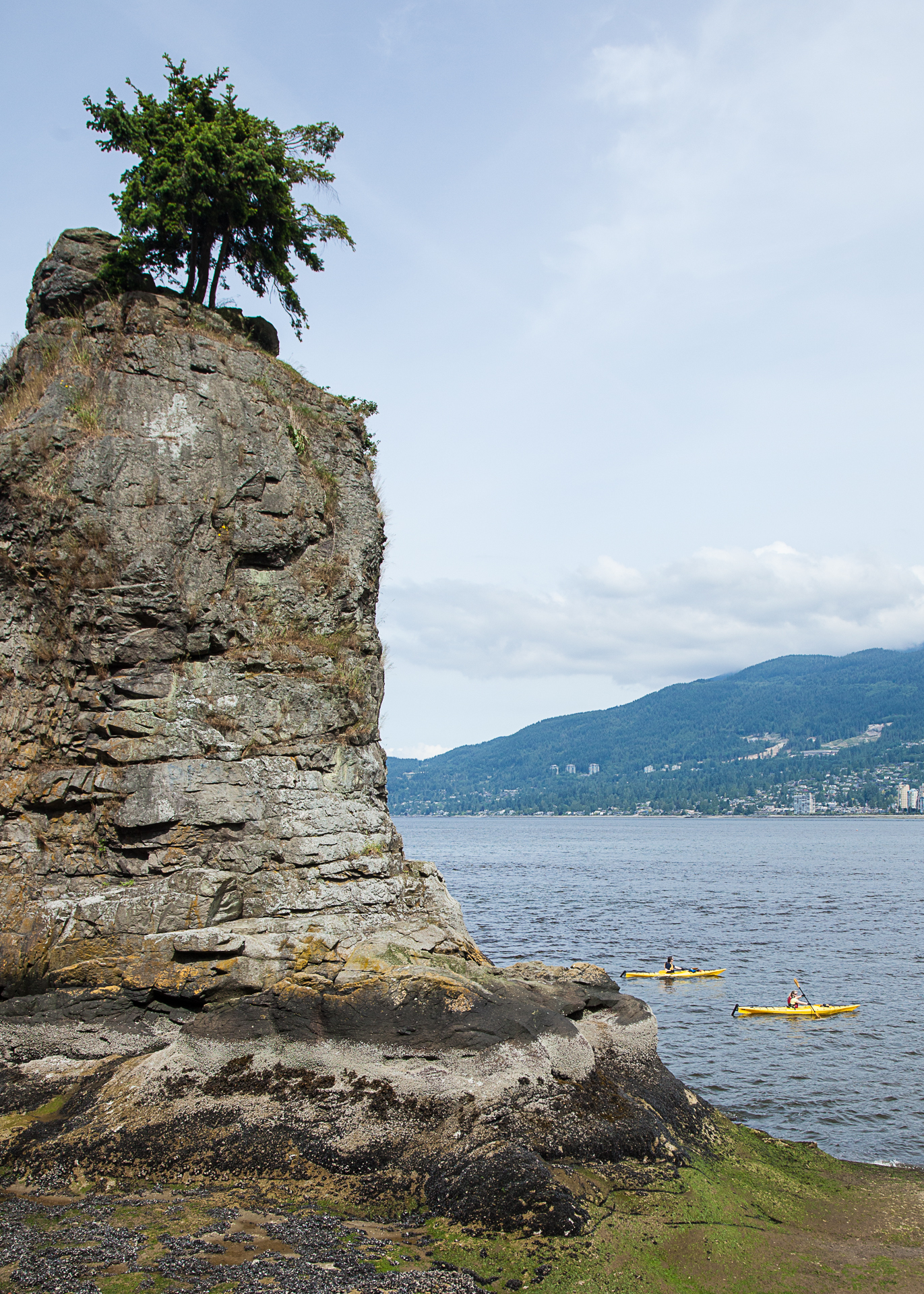 Sea kayaks cruising by Siwash Rock