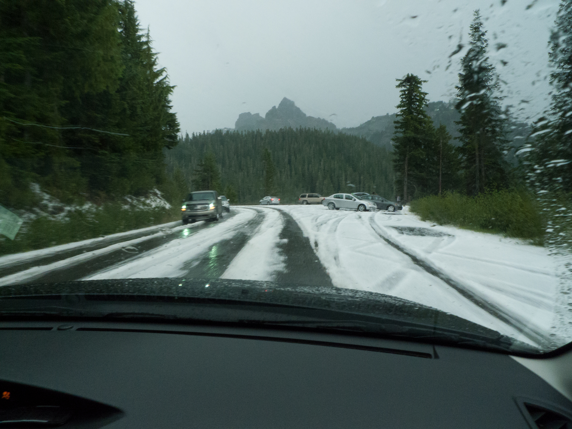 Yes that is snow/hail covering the road in August. You never know what you'll get on the mountain.