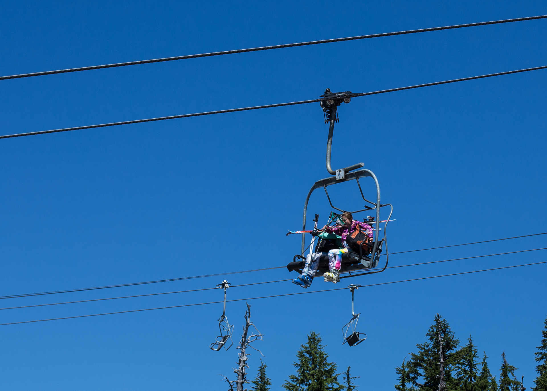 Summer skiers on the chairlift.