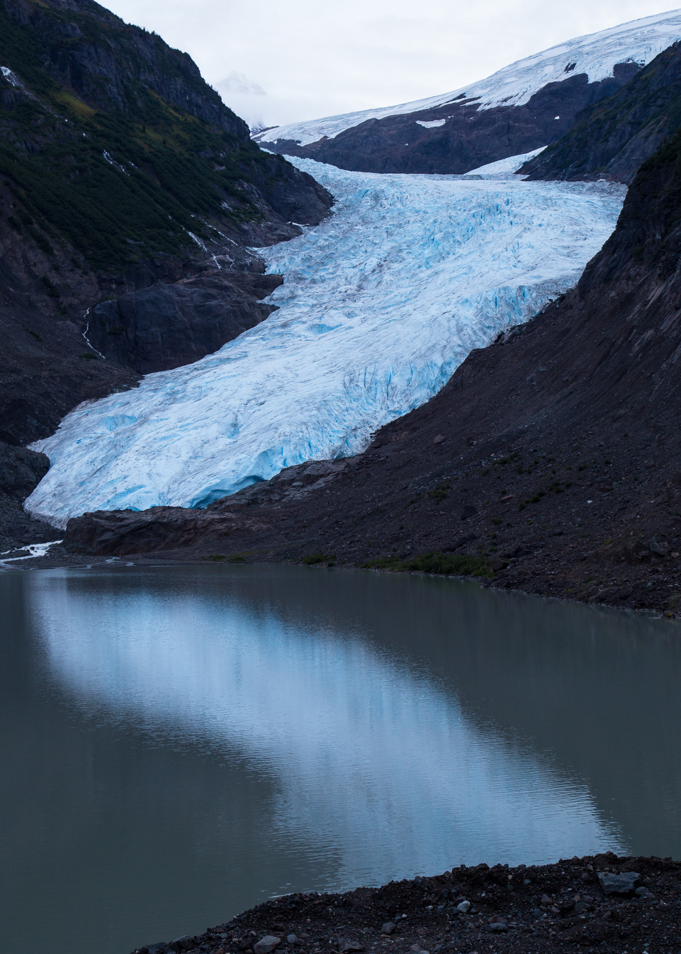 The BEar Glacier glowing on the water in the twilight.