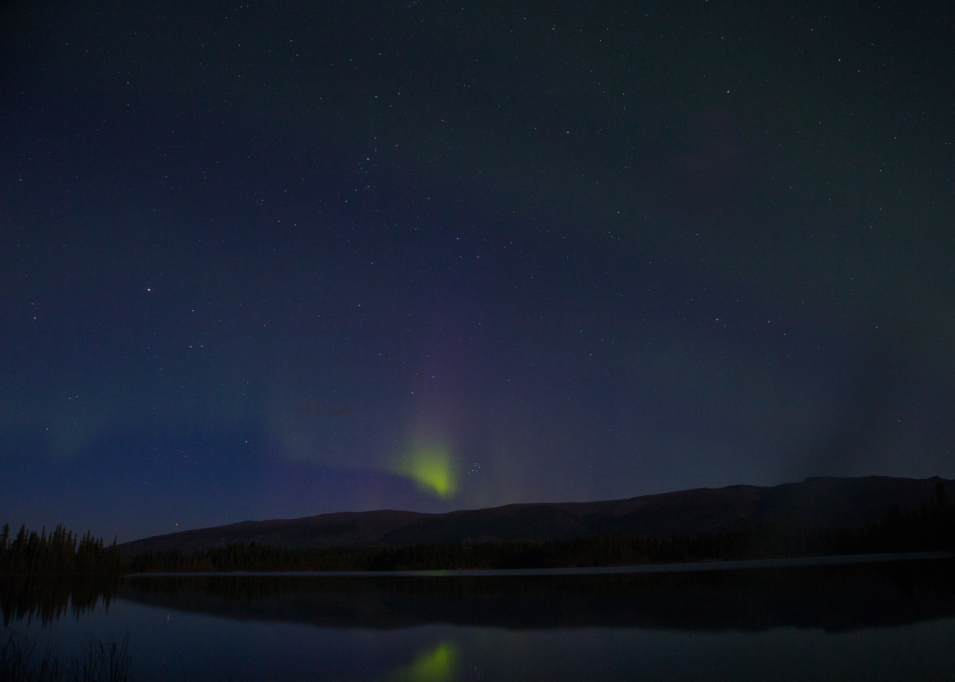 The Northern Lights started modestly, with a bit of colour just over the mountains to the north.
