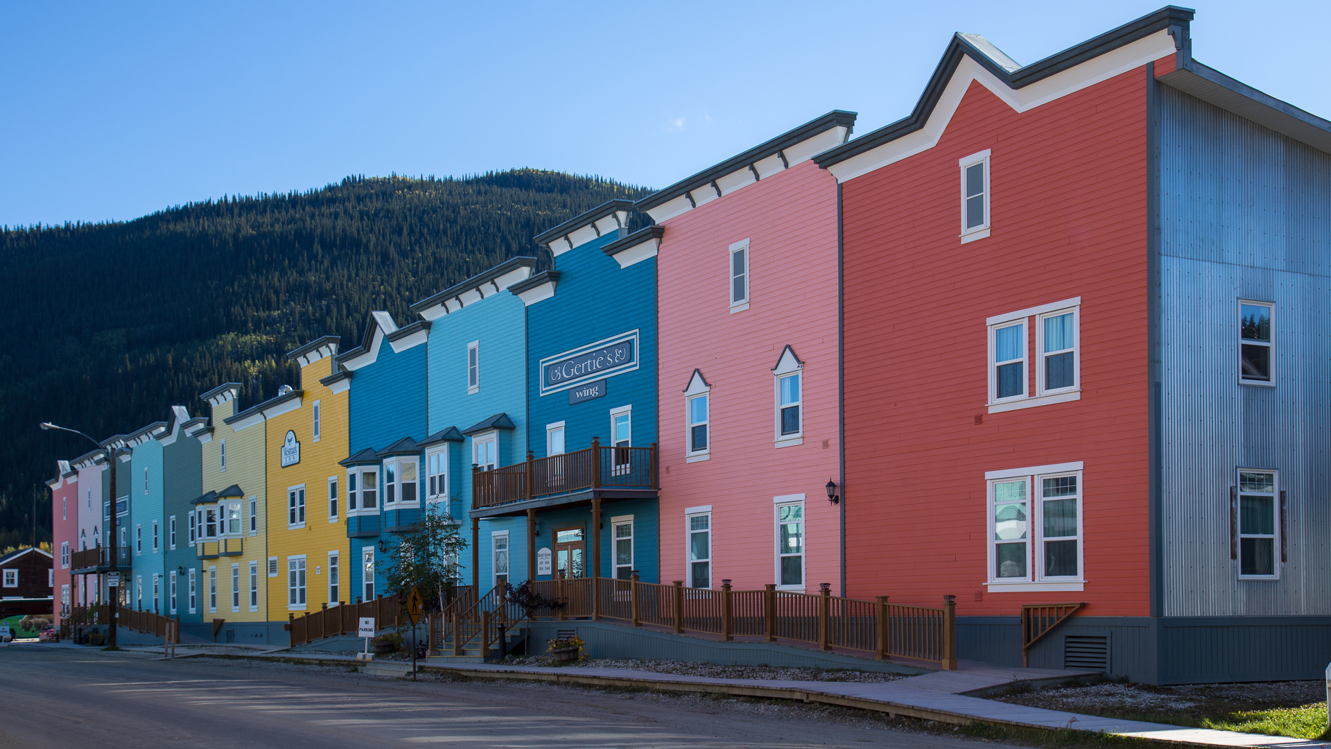 Visible from miles away, the brightly coloured facades on the original rooming houses.