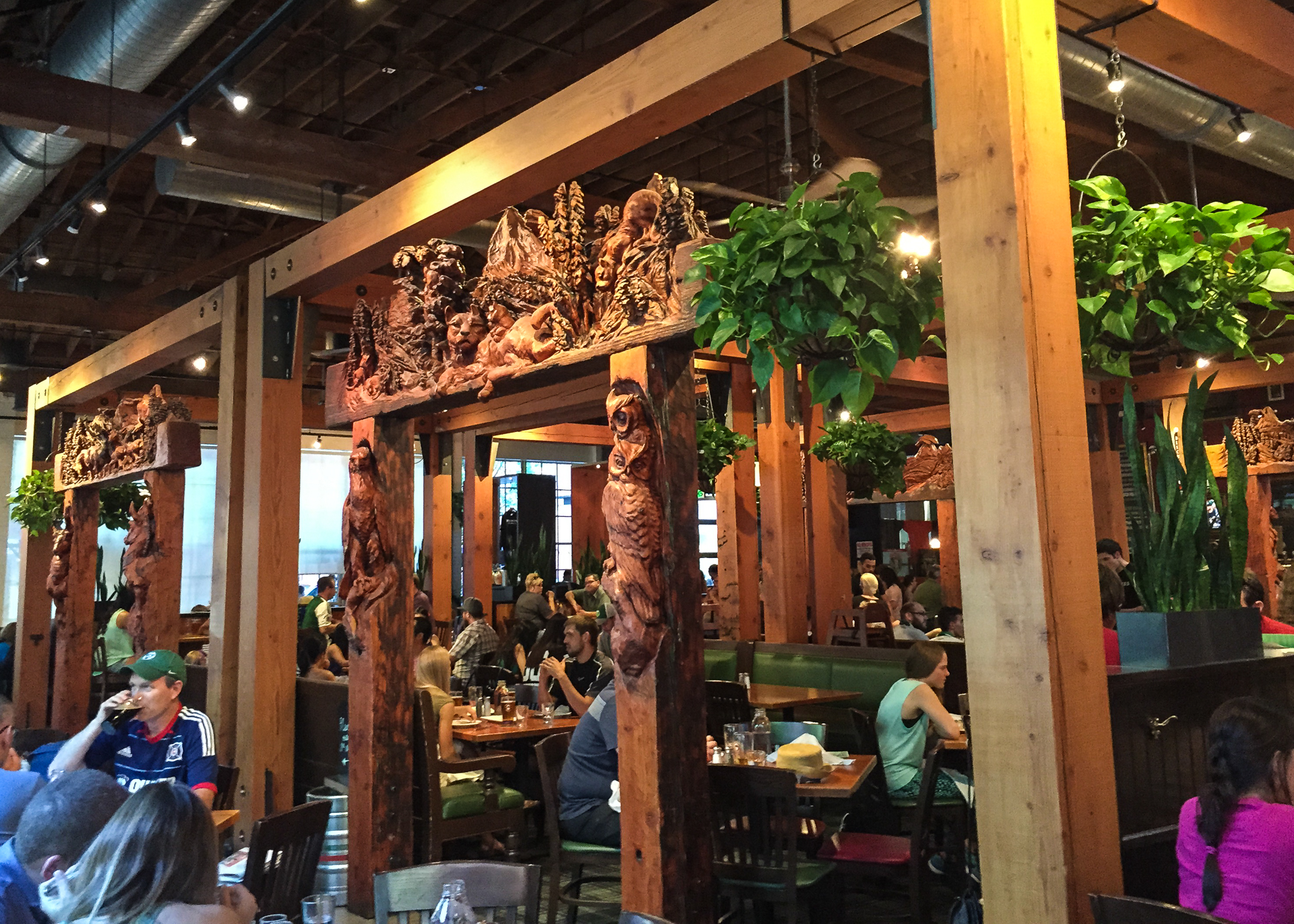 Inside Deschutes, they have all these amazing carvings separating the seating areas.