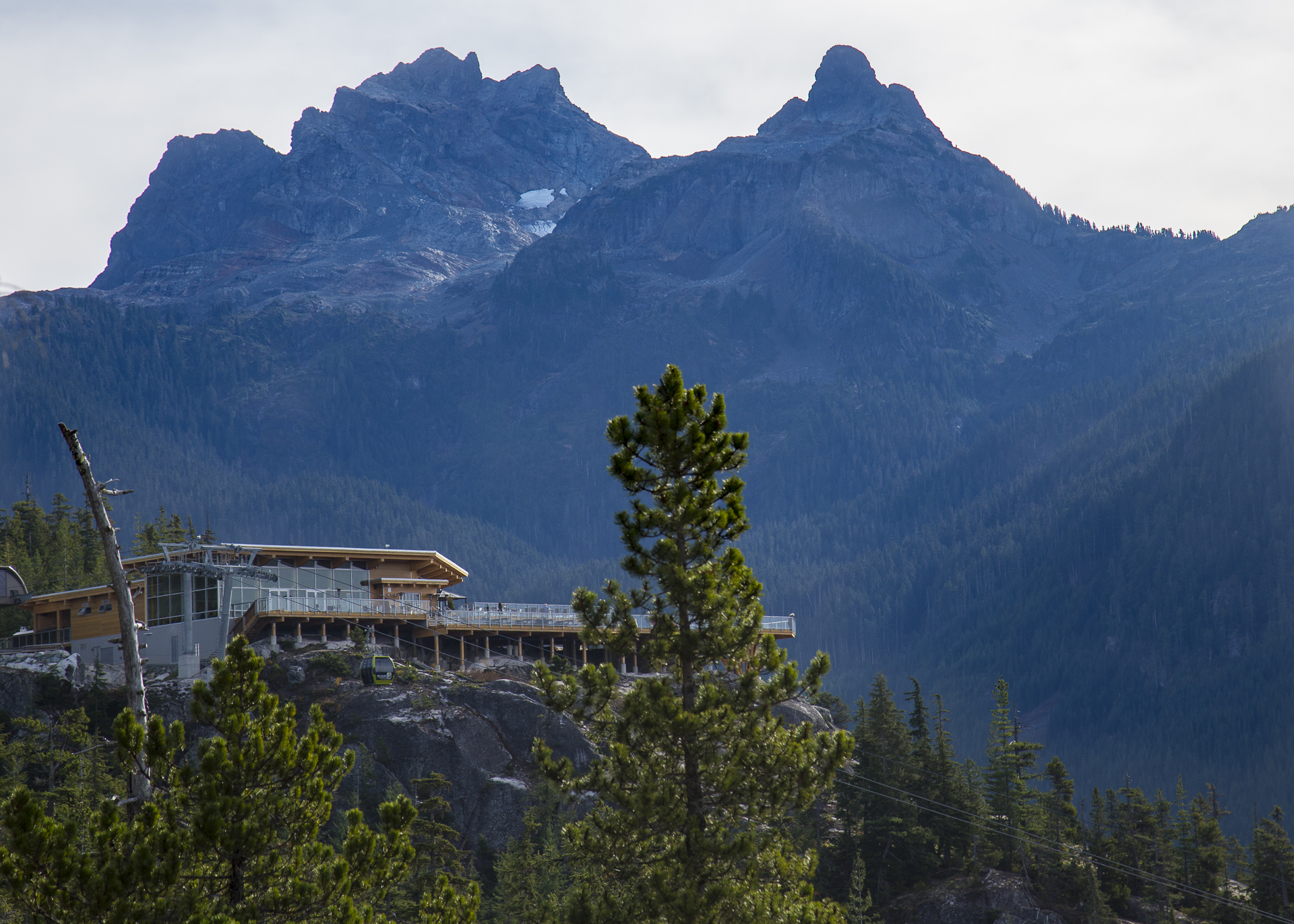 The chalet, with mountains looming in the background.