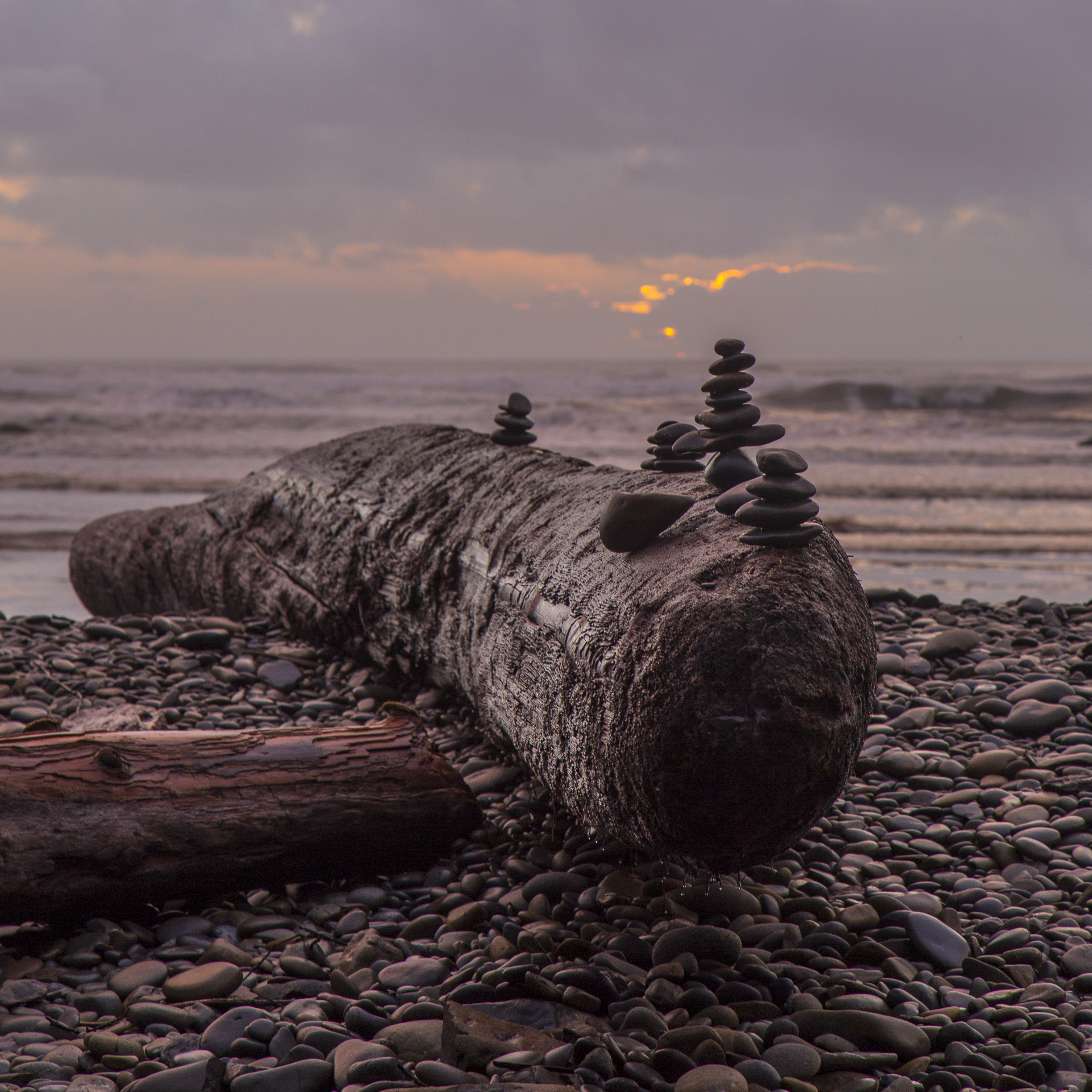 Rock sculptures on Ruby Beach as the sun sets.