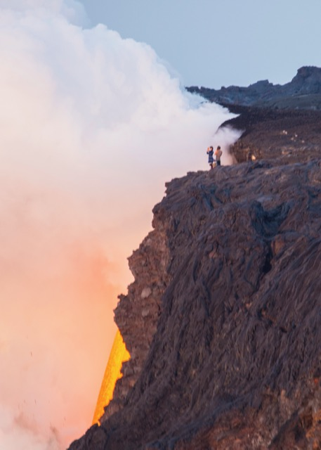 A close up view of the lava fountain pouring into the ocean. And yes, those dumbass people are standing at the top of it, with their small child - the whole cliff face is unstable and could (and has recently) go crashing into the ocean.