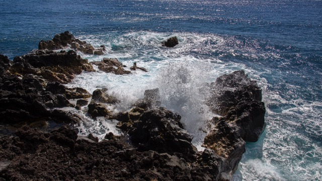 A small blowhole on the rocks down at the end of the trail.