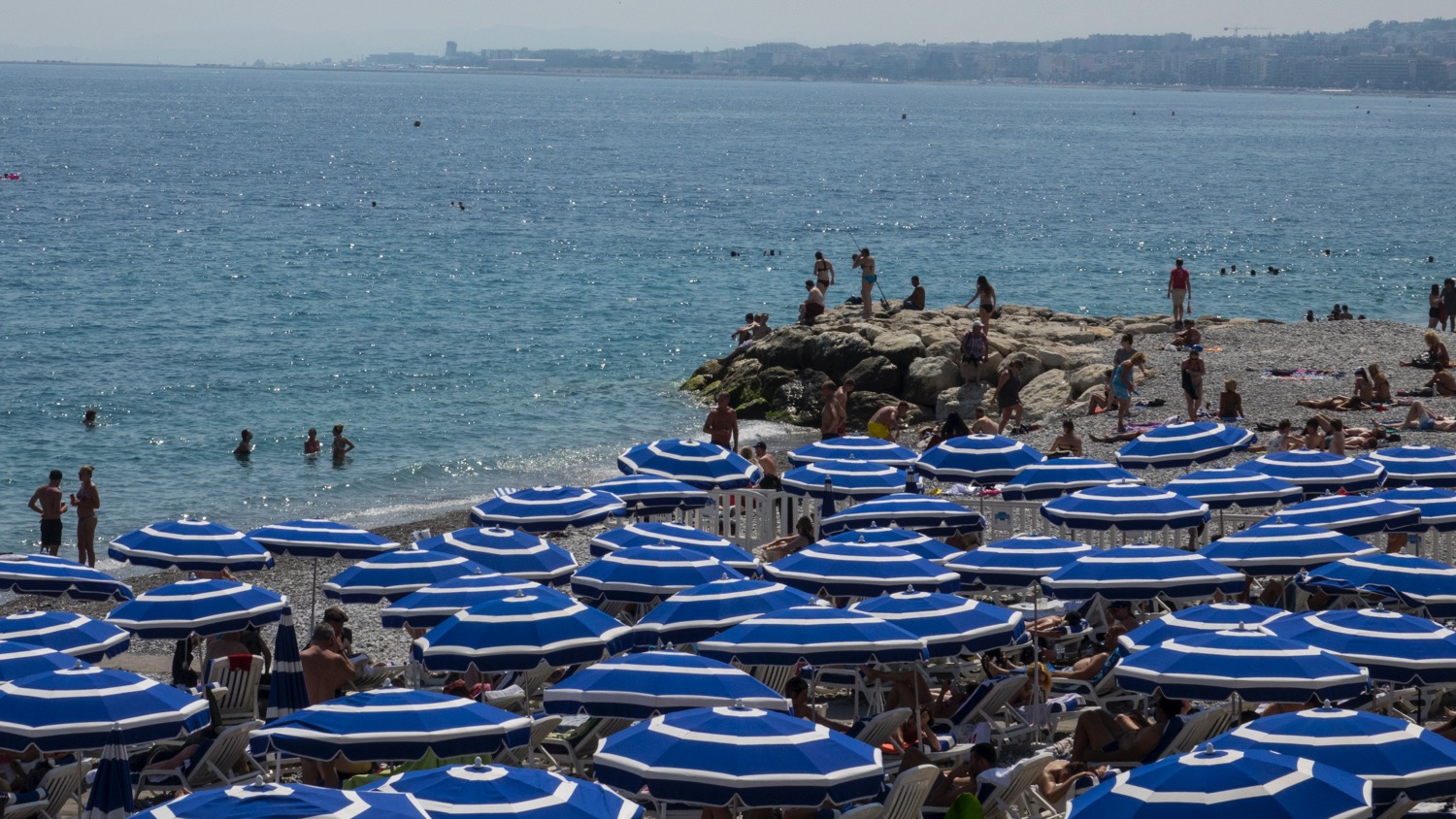 A look out across one of the private beach clubs, over the blue waters of the bay.