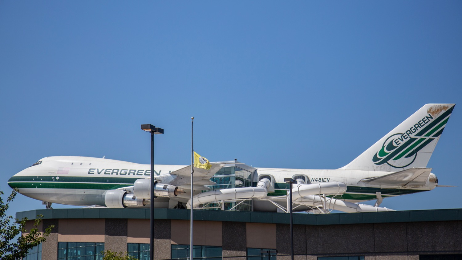 Seriously - the waterslides come out of the 747 on the roof of the place.