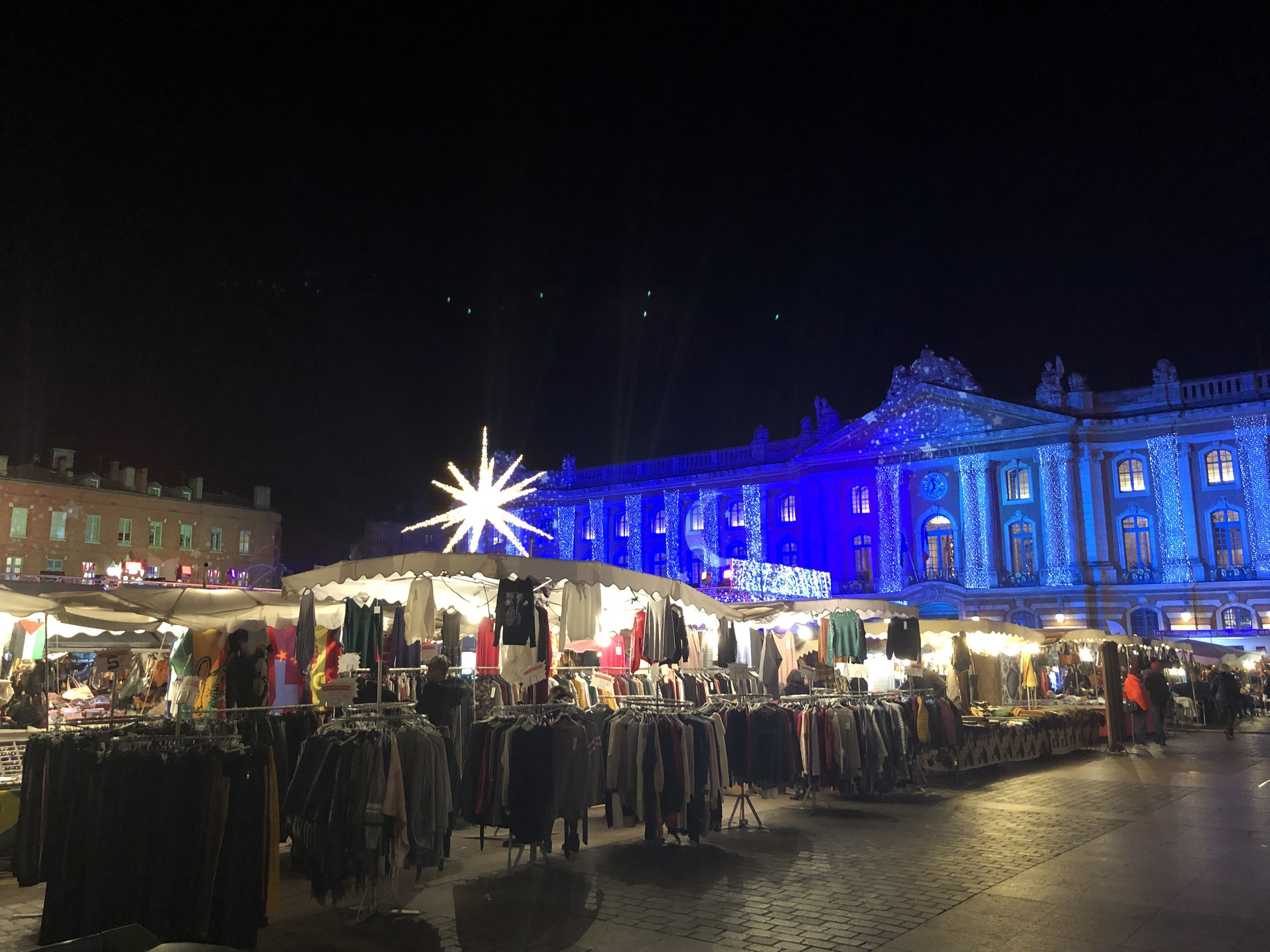 The Christmas market outside the city hall, all lit up for the holidays.
