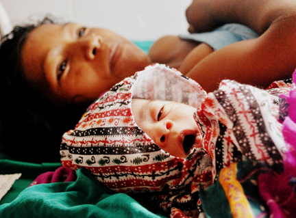 newborn_yawning_mom_sm_2.jpg