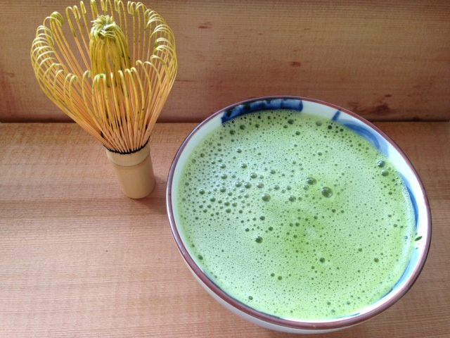 Matcha Latte: matcha powder, hot water, and heated almond milk