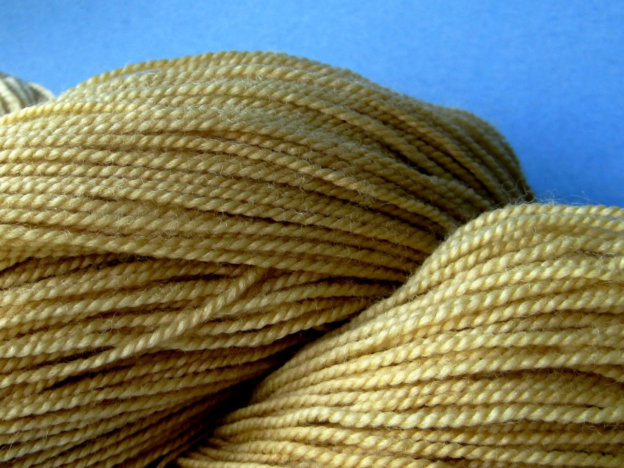 Wool yarn dyed with dried pomegranate rinds