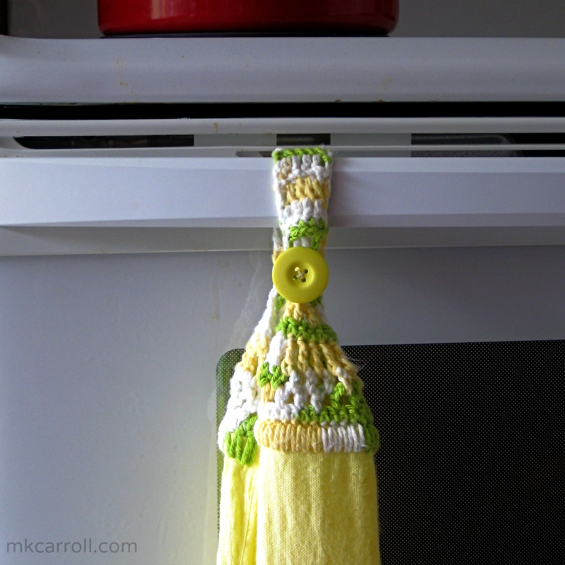 Kitchen towel with crocheted hanging loop