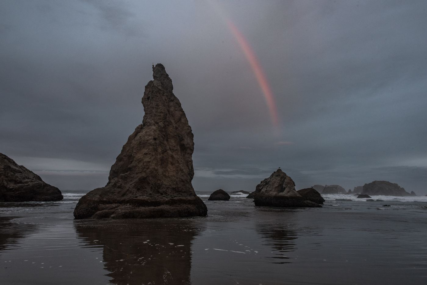 Misty Rainbow over sea stacks