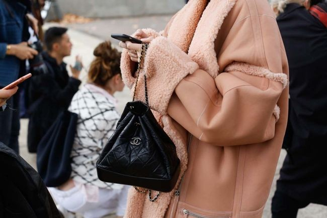 A black Chanel Pouch, captured by the Street Smith for Vogue Australia