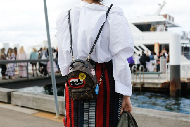 A mini customised Louis Vuitton back-pack, captured by the Street Smith for Vogue Australia
