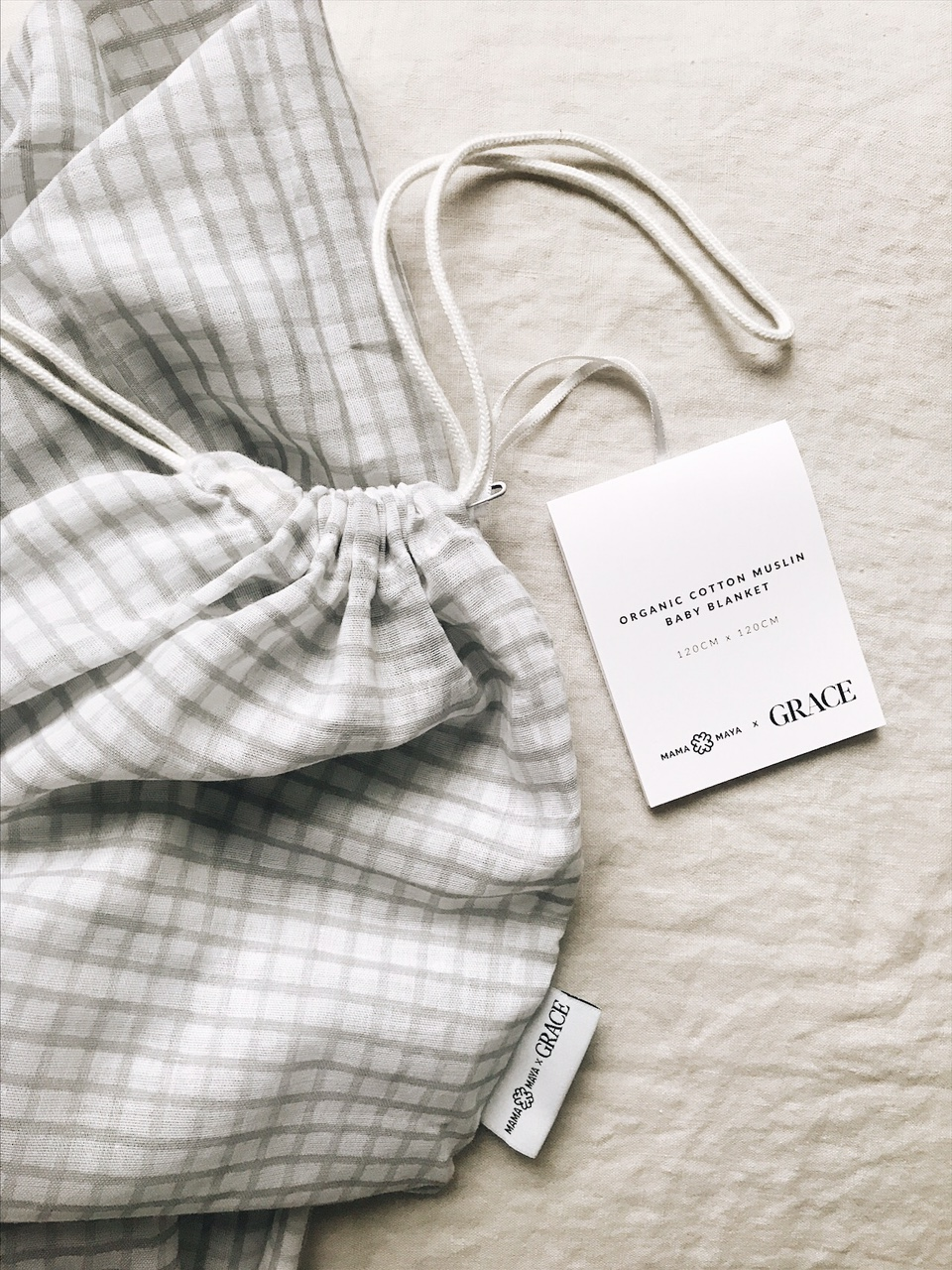 The GREY GINGHAM MAMA MAYA X GRACE muslin swaddle