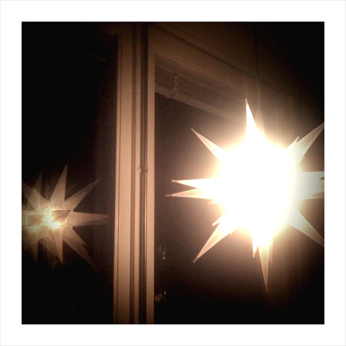 iPhone photography: Advent star with window reflection.