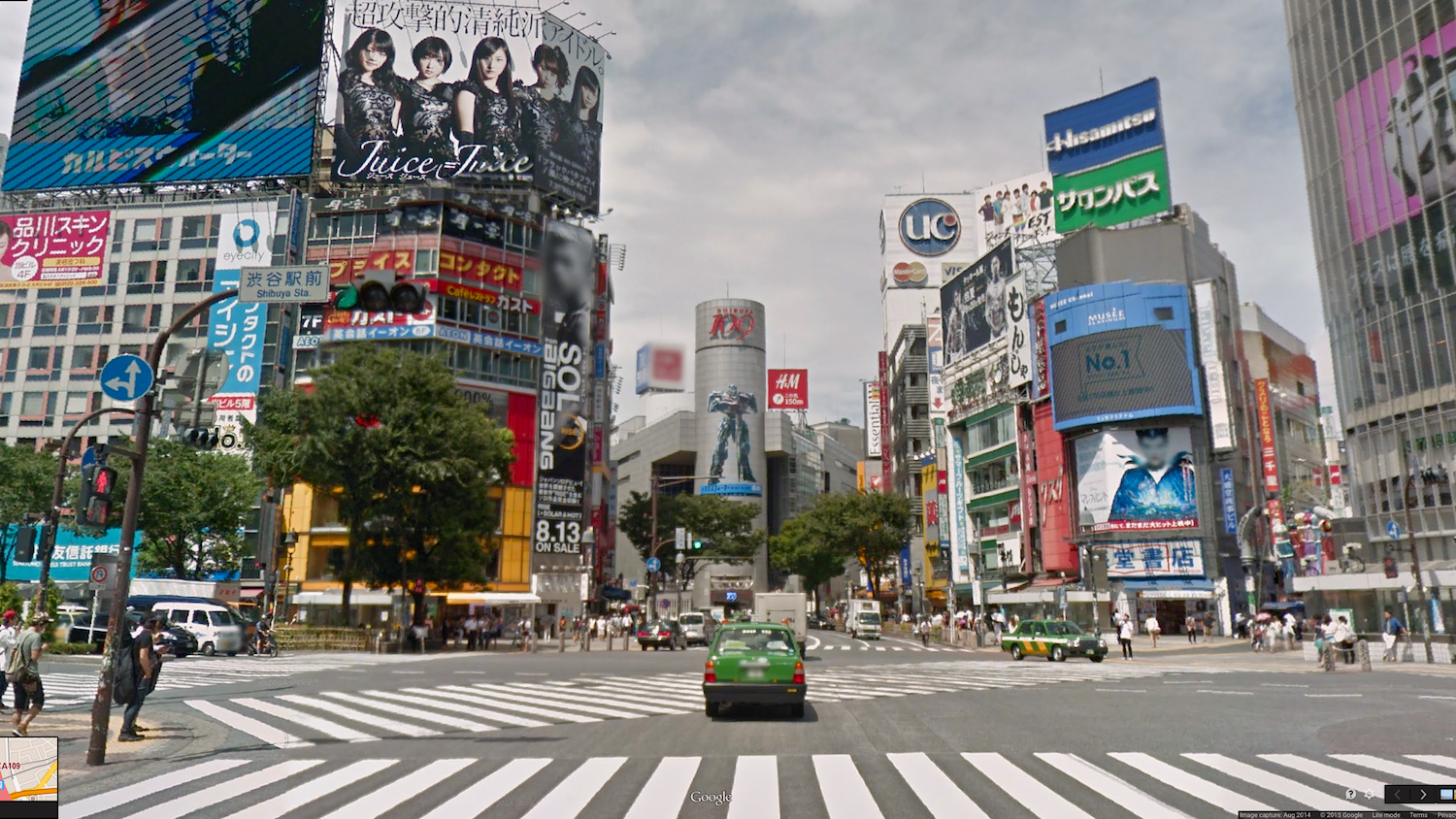 The real one is the one with the giant robot on the building in the middle. Sources  here  and  here  .