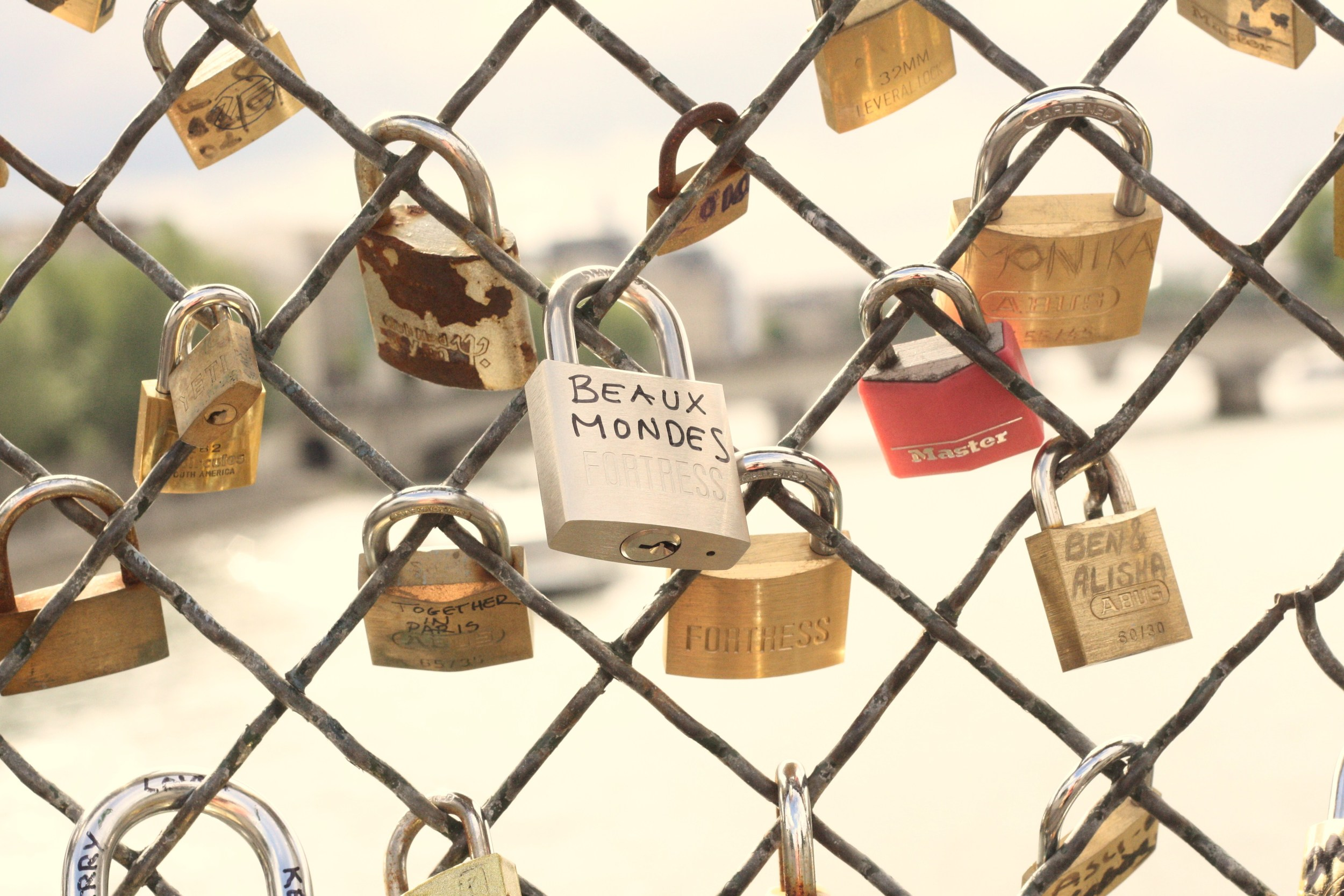 Our love lock, on the 'Lover's Bridge' over the Seine River in Paris