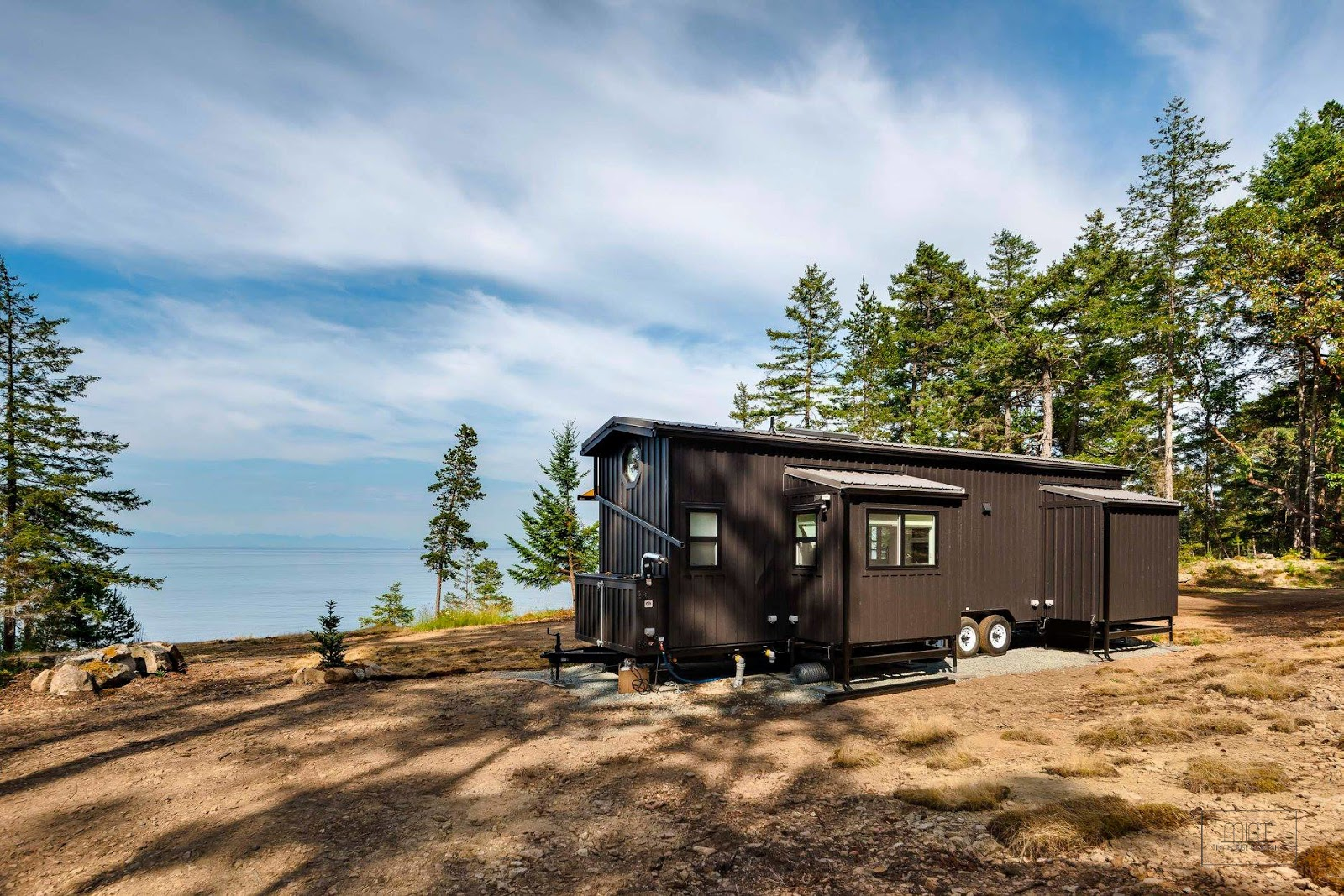 36' tiny house with double slide outs by Mint Tiny Homes
