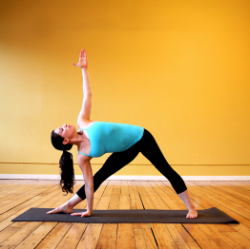 I'm not this flexy either. Don't fret. Just put your bottom hand on the inside of your front leg. You can move it as high or low as you need to feel like your chest can open. Triangles are the strongest geometrical shape, so be gentle with your body in it's progression so you can embody that:).