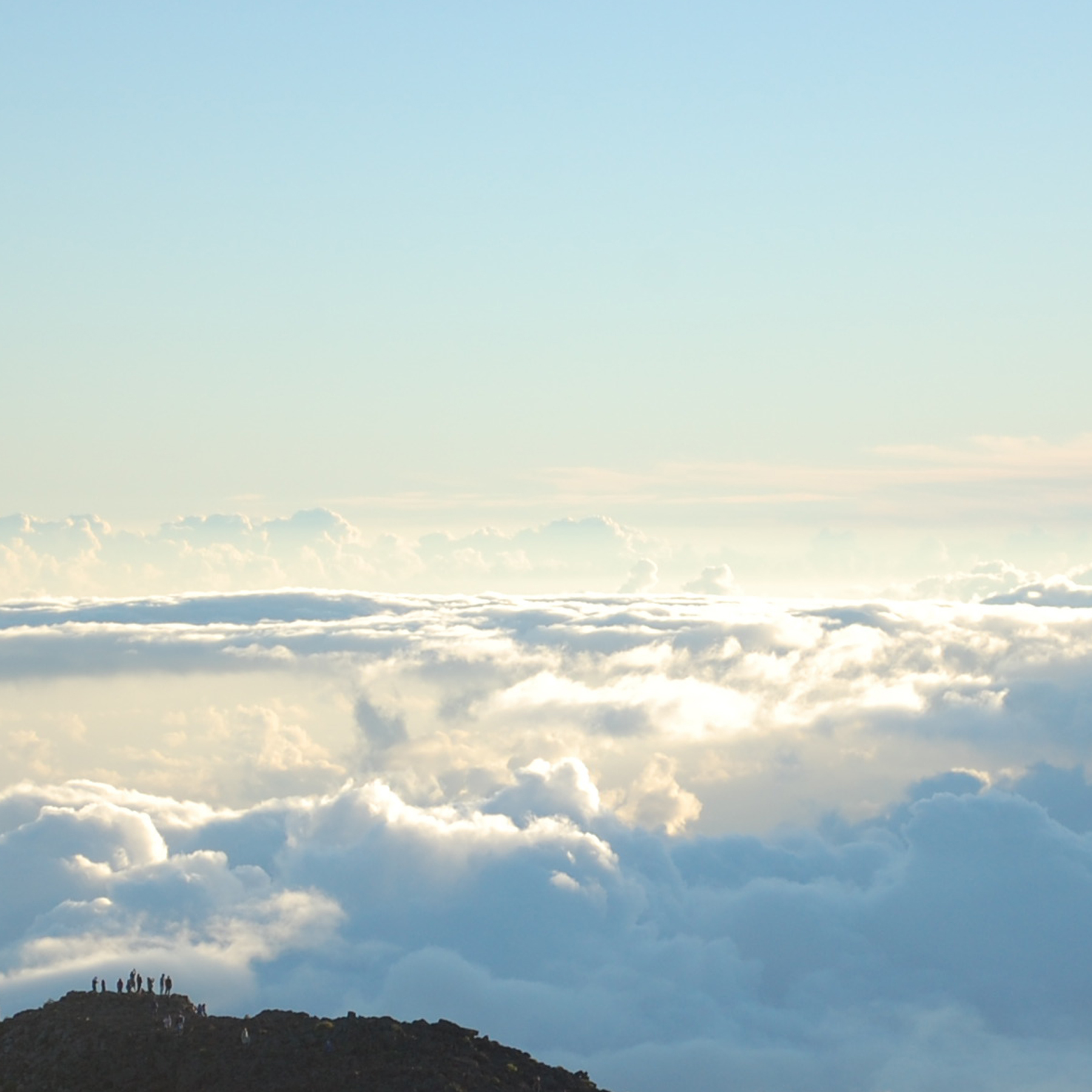 Sitting above the clouds at sunrise.