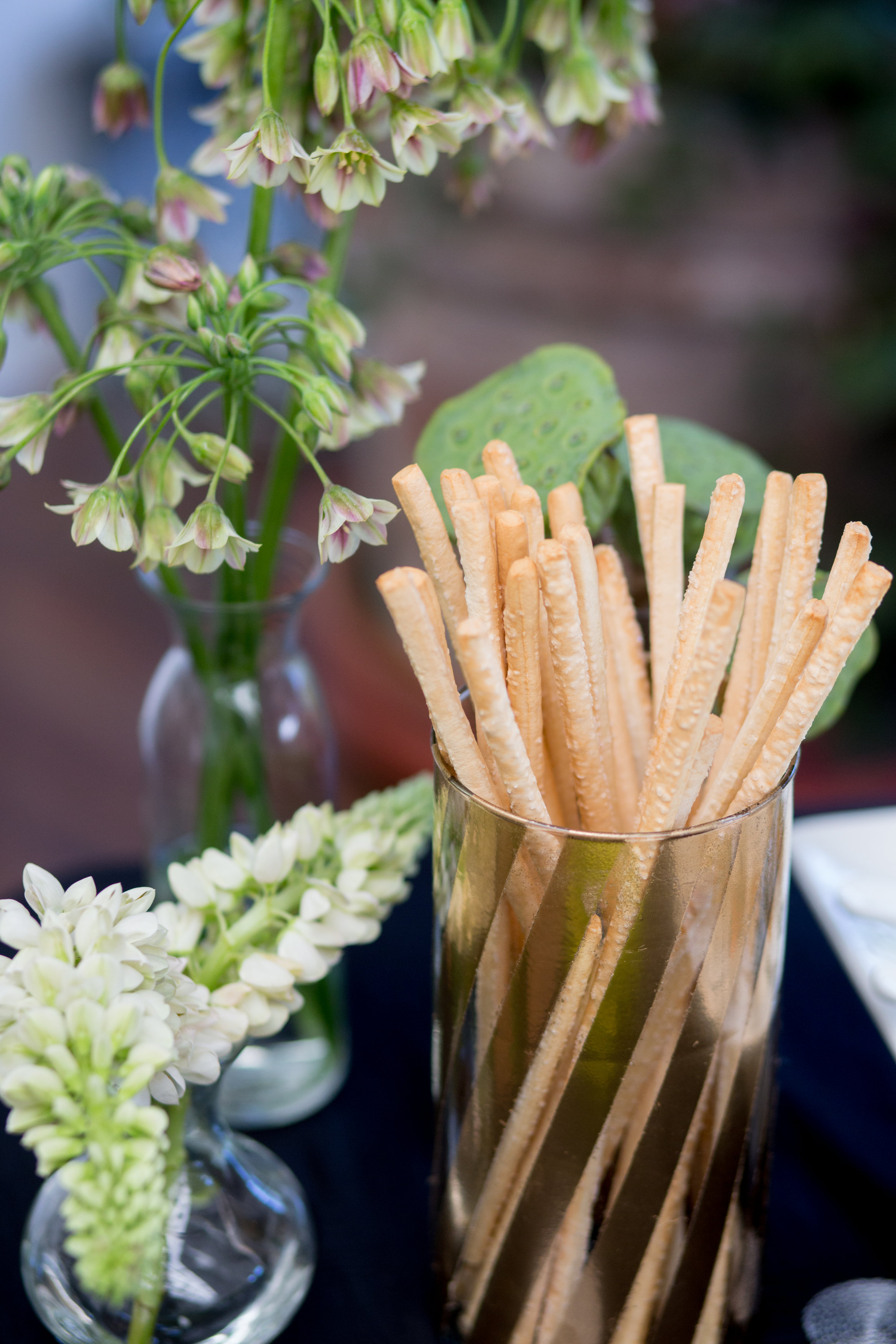 JennaBethPhotography-LGWConservatory-buffet-gold-bread-sticks-flowers.jpg