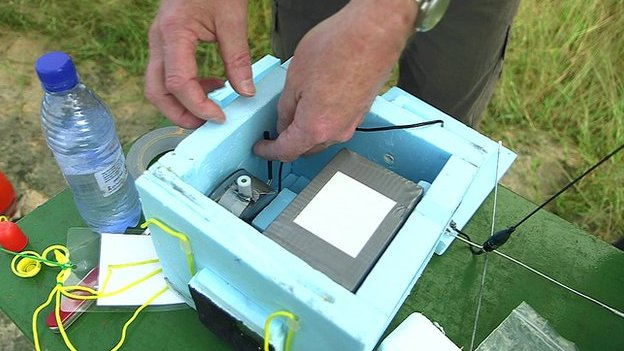 Preparing the insulated instrument module in the Malawi countryside (Source: BBC)