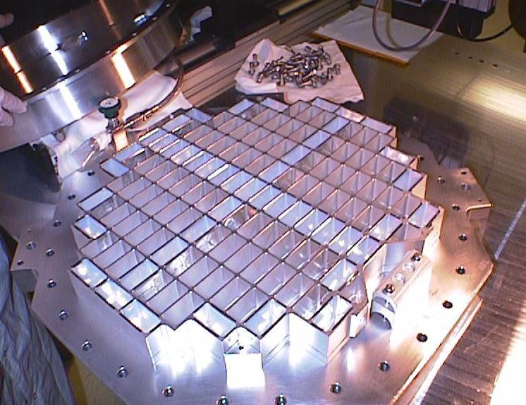 Almost half of Stardust's aerogel collector cells are waiting for dusters' attention.   Credit: Nasa/JPL-Calt    ech