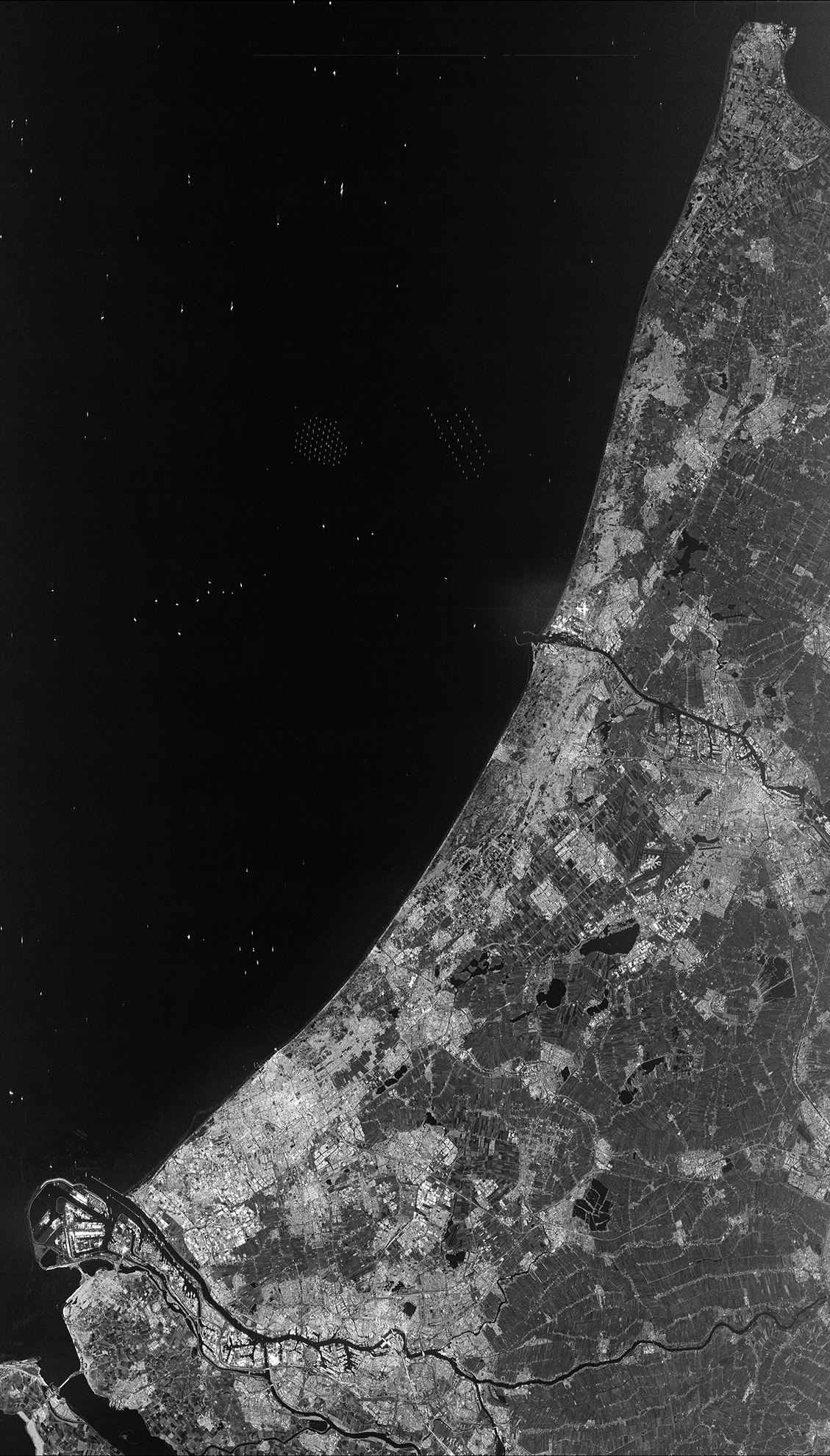Sentinel-1A radar image of the Netherlands lets scientists monitor changes in agricultural land cover and ocean pollution.  Credit: Esa