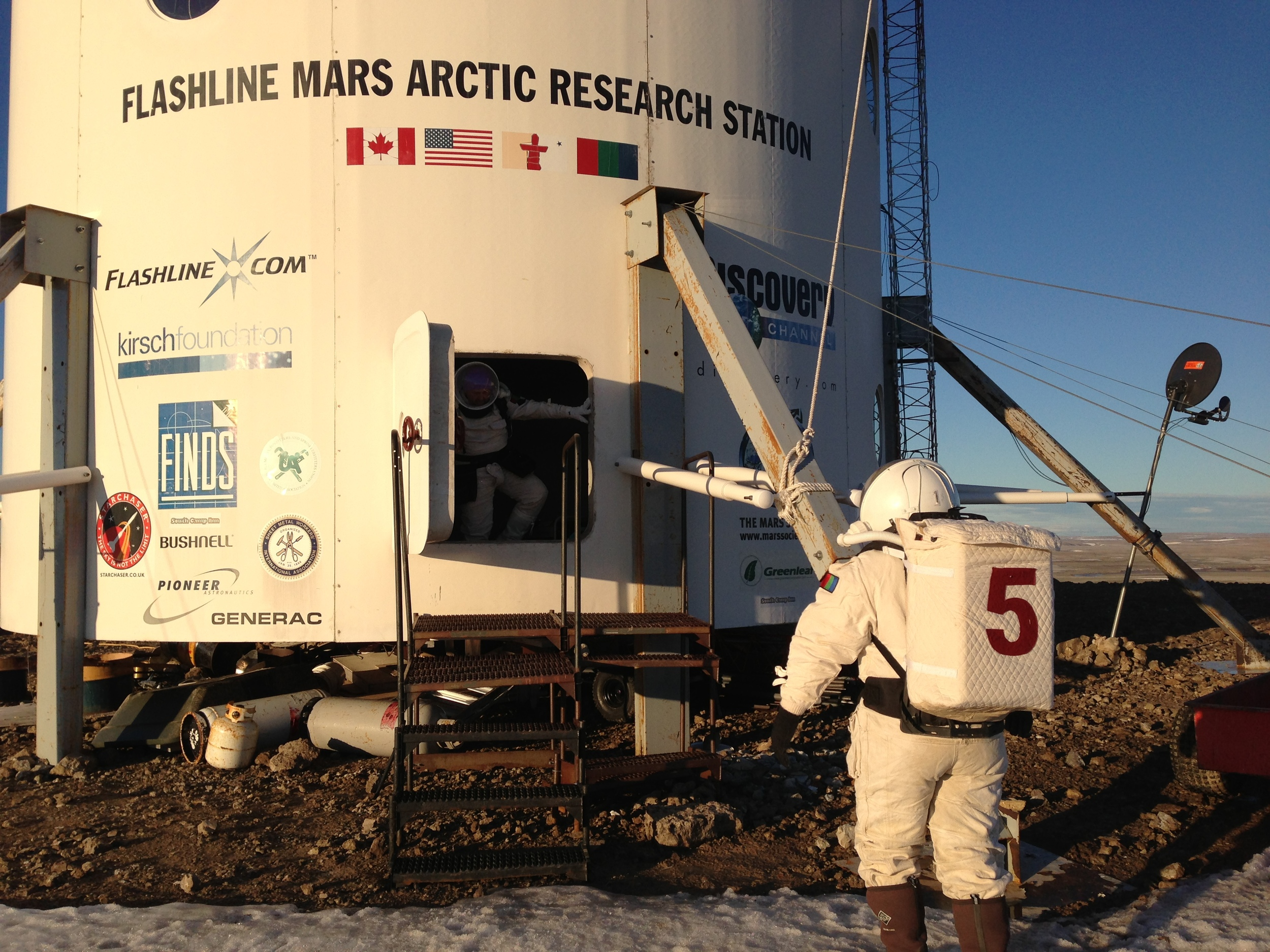 """Keeping it real - or close to it. Everything the crew at FMars does must simulate a real mission on Mars. Want to go for a walk? Put on your spacesuit, sit in the airlock to """"decompress"""", and then conduct your extravehicular activity. But watch out for the polar bears. Source:  Mars Society MA365 Project"""