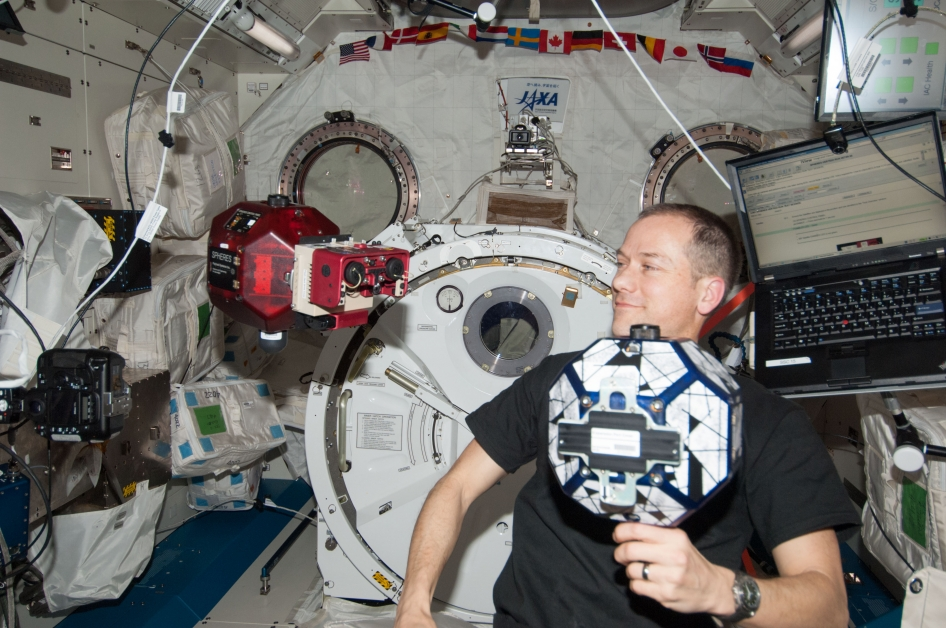 """Spheres, short for """"SynchronizedPosition, Hold, Engage, Reorient Experimental Satellites"""" help space engineers test satellite control software within the safe confines of the International Space Station. Zero Robotics competitions letmiddle and high school students in the United States and Esa-member countries program the robots themselves. Credit:  Nasa/ISS"""