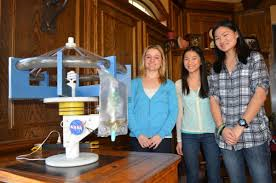 Chicks In Space (l-r) MaryAnn, Adia, and Lilly Bulawa with their prototype hydroponic centrifuge.  Source: Chicks In Space