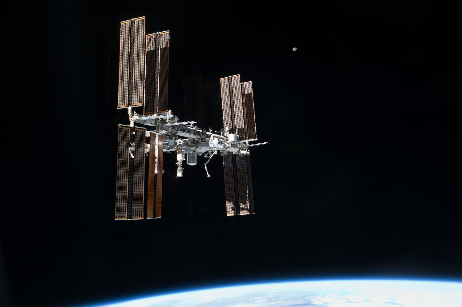 That's no moon... oh, wait. Yes it is. Nothing amateur related. Just a gratuitous image of the International Space Station in TIE Fighter configuration. Source:  Nasa