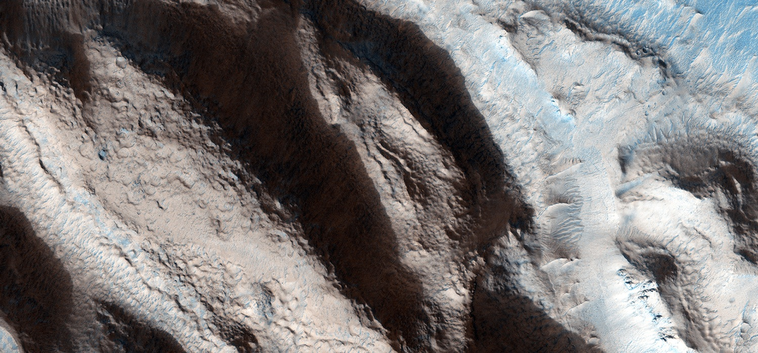 Ice or water may have carved this valley in Arabia Terra.  Credit:  Nasa/JPL-Caltech/University of Arizona