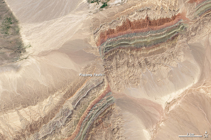 This is my favorite for the finals in Nasa's Earth Observatory Tournament Earth ( link ) It shows a fault line in the hills of China's Xinjiang province.  Credit: USGS/Robert Simmon and Jesse Allen