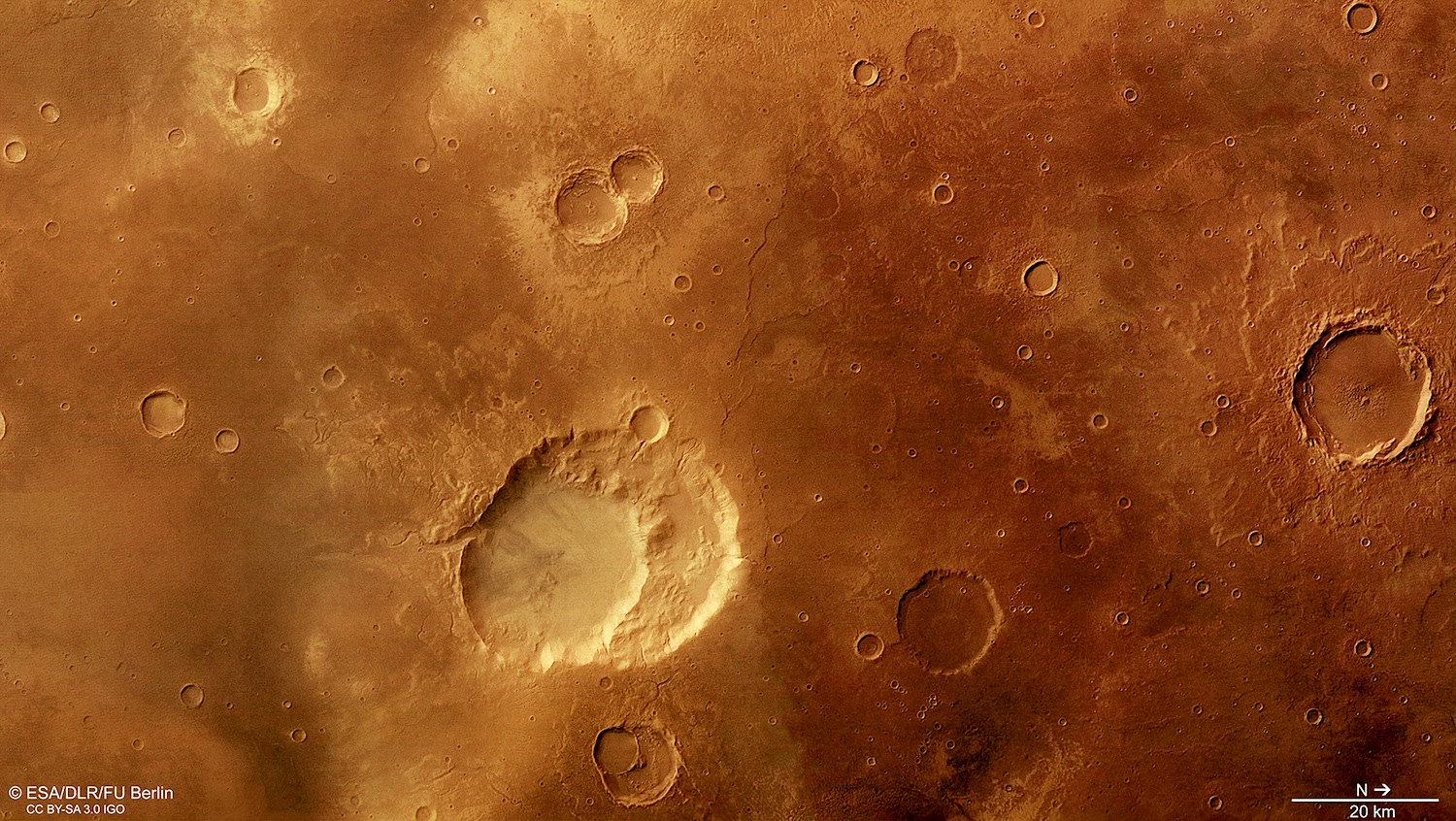 The 30 kilometer by 40 kilometer craters of Siloe Patera may be the remains of an ancient supervolcano.Similar to the supervolcano beneath Yellowstone National Park, a large volume of magma may have built up beneath the Martian surface. A massive eruption releasing more than 1000 cubic kilometers of material could explain the geology of Siloe Patera's two nested craters.  Credit:  Esa/DLR/FU Berlin   CC BY-SA 3.0 IGO