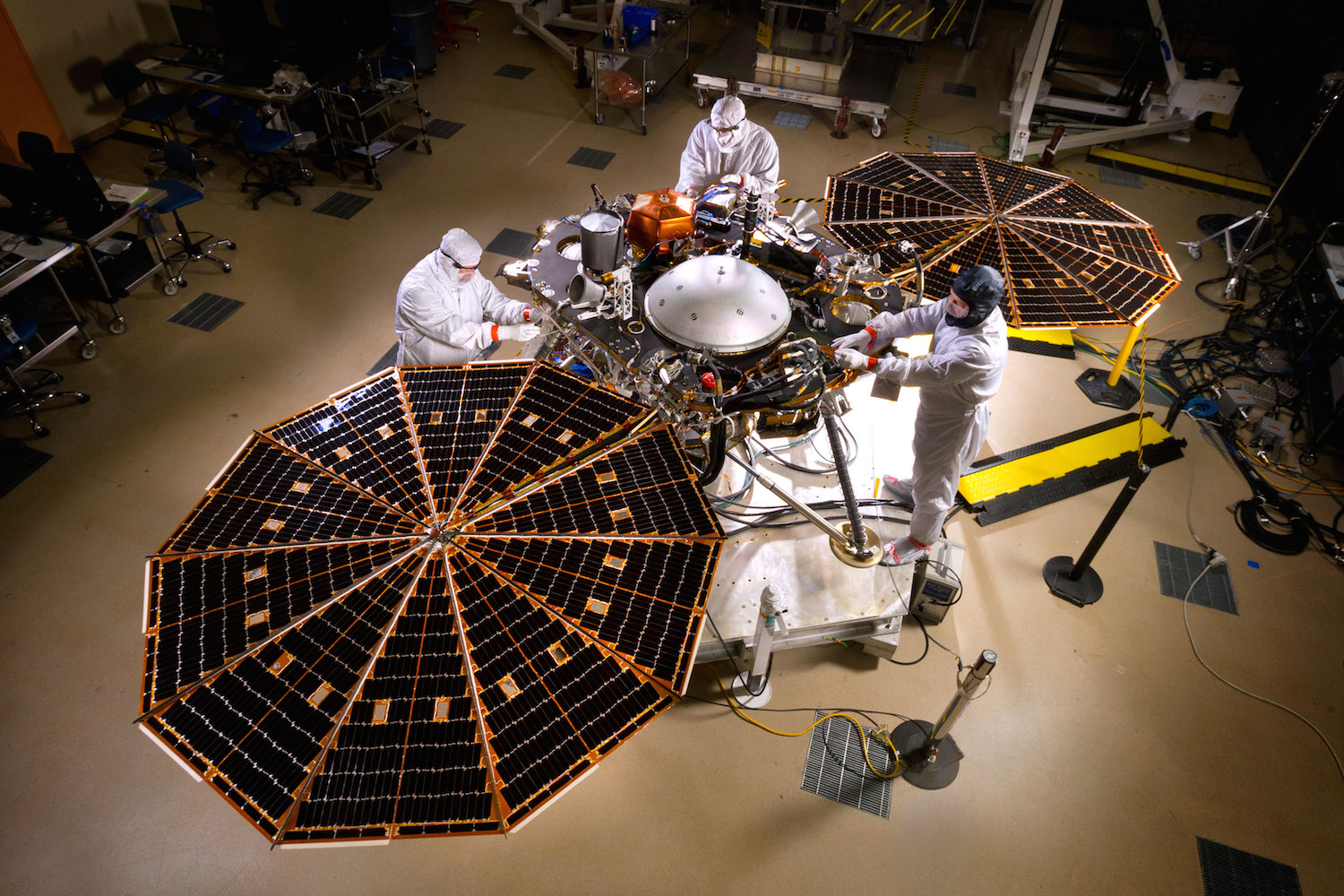 The great thing about being a Lockheed Martinengineer? Mood lighting. Based on a platform developed for the successful Pheonix mission,Nasa's Insight mission will explore the interior of Mars. Credit:  Nasa/JPL-Caltech/Lockheed Martin
