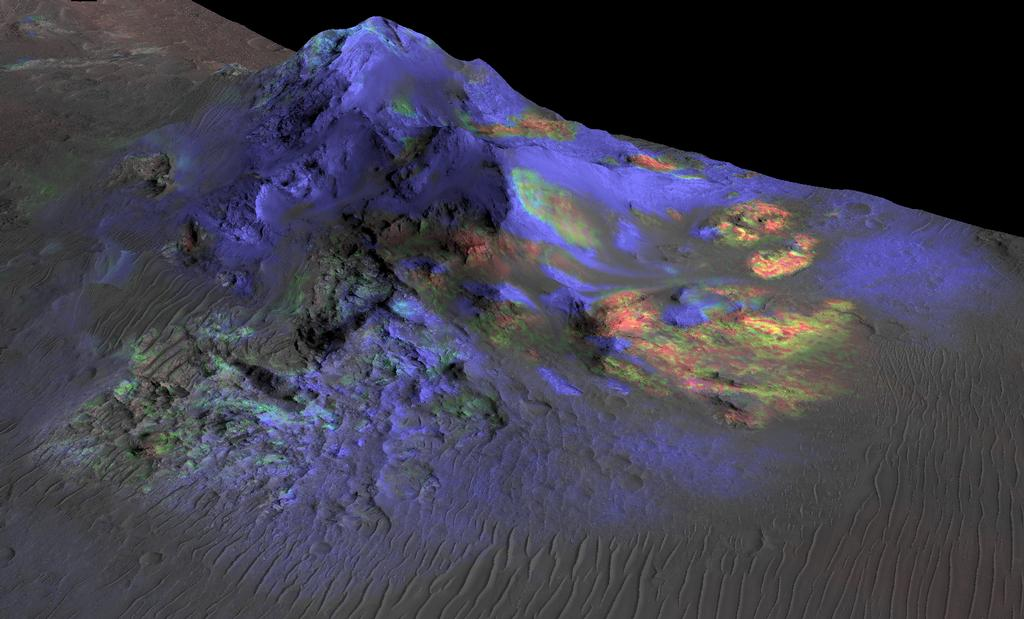 The green splotches in this Nasa image indicates the presence of glass deposits in the central peak of Alga Crater. The image combines topographical data (grey) from the HiRise camera and spectral data (color) from the Crism instrument on Nasa's Mars Reconnaissance Orbiter.  Credit:  Nasa/JPL-Caltech/JHUAPL/University of Arizona