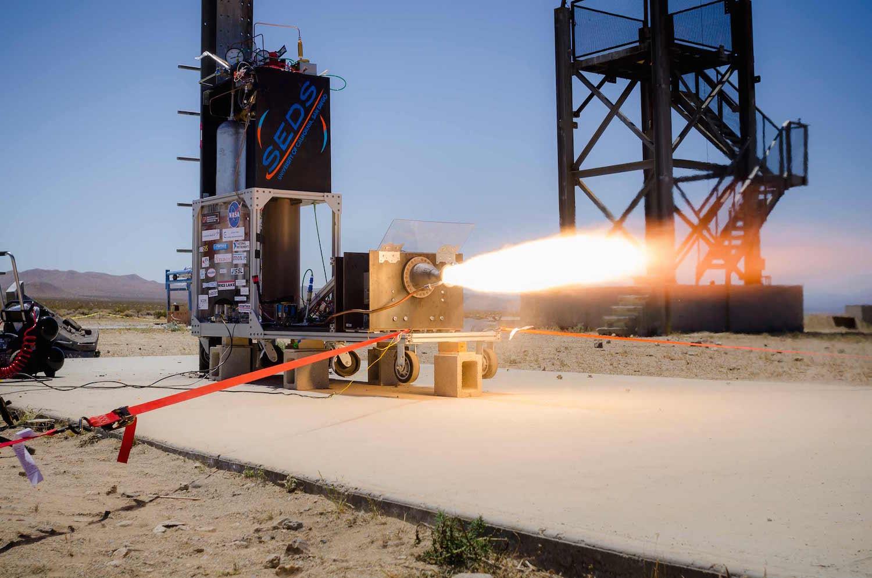 Test firing of a 3D printed rocket engine designed by undergraduates at the University of California San Diego. Credit: Erik Jepsen/UC San Diego Publications