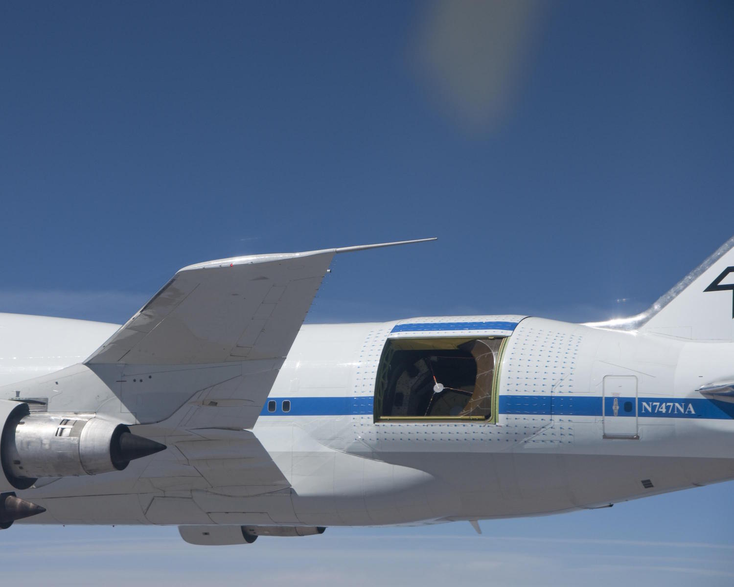 Do you feel a draft? Nasa's modified Boeing 747 carries a 100-inch infrared telescope to altitudes 10,000 feet higher than commercial aircraft fly. Above the light-absorbing moisture of the lower atmosphere the flying observatory supports research no ground-based telescope can do.  Credit:  Nasa/Jim Ross