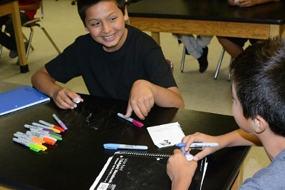 """7th Grade Noli Indian School students prepare their """"PongSat"""" ping-pong balls for launch. Credit:  Soboba Casino"""