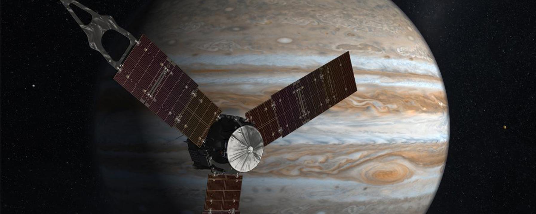 An artist's vision of the Juno spacecraft orbiting Jupiter. Credit: Nasa