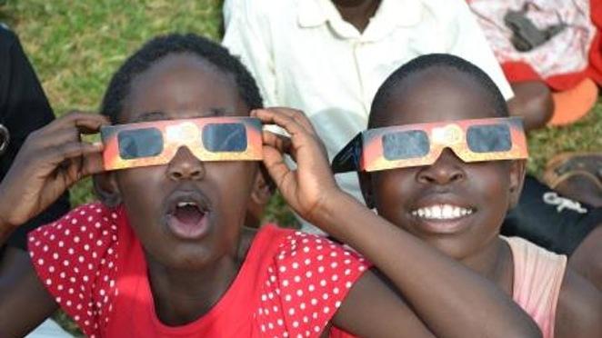 Help African kids watch a solar eclipse