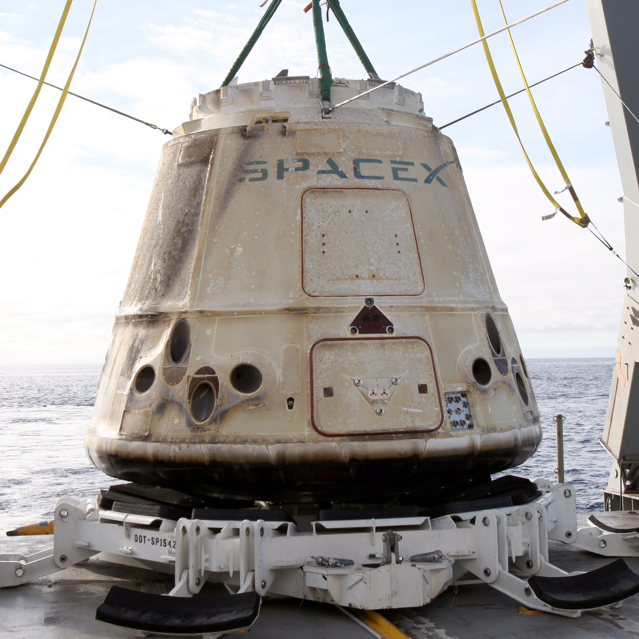 A little charred on the outside, but the student experiments that rode the Dragon back from space should be fine. Credit: SpaceX