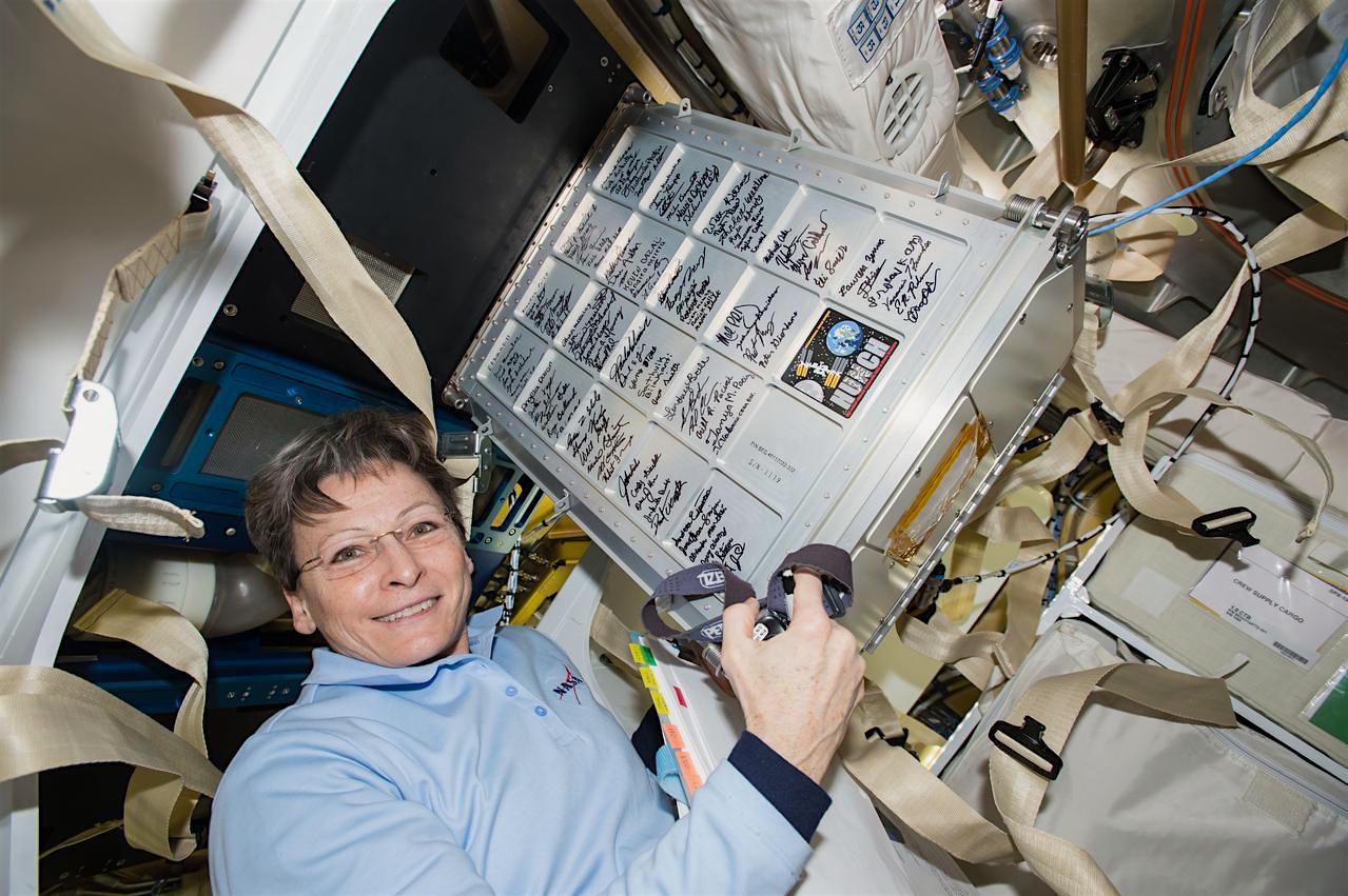 Nasa astronaut and International Space Station Commander Peggy Whitson holds a small storage locker built by high school students in the space agency's Hunch program.  Credit: Nasa