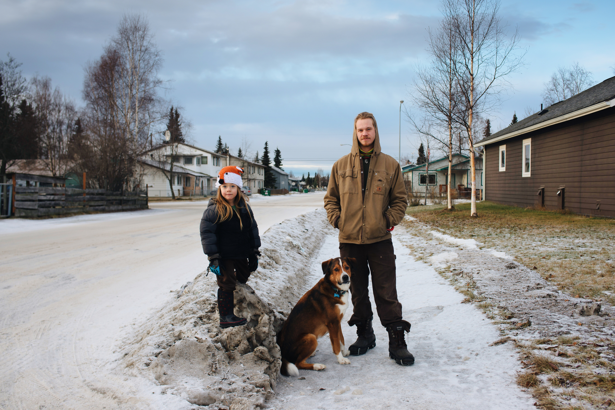 Nick Jenkins out for a walk with his son, Cedar and his Pup, Bora. Mountian View, Anchorage. January 2015.