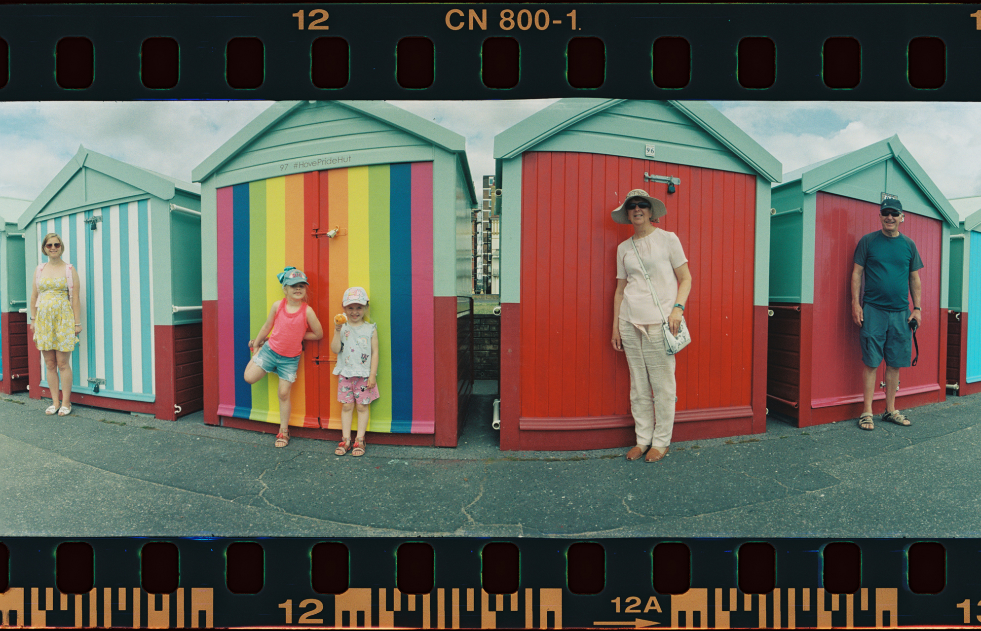 Here's my family against beach huts in brighton.   kind of fun shot!